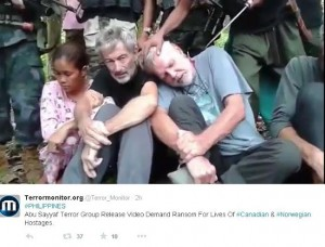 Canadian John Ridsdel, 68, while being threatened by one of his captors in these photos previously posted by Terrormonitor.org on their website that also show fellow Canadian Robert Hall, 50; and a Norwegian man Kjartan Sekkingstad, 56, and his Filipina girlfriend, Maritess Flor. (Mindanao Examiner)