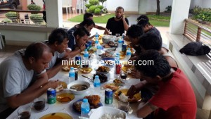 Sulu Gov. Totoh Tan speaks on the phone while feeding the 10 Indonesian sailors who were freed by the Abu Sayyaf in Jolo town in the southern Philippines on May 1, 2016 after more than a month in captivity. (Mindanao Examiner)