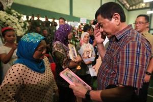 President Rodrigo Duterte condoles with families of slain soldiers in Zamboanga City on Wednesday, August 31, 2010. (Photos by Michael Rey Baniquet)