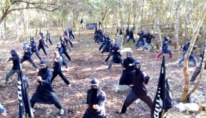 Members of the Khilafah Islamiyah Movement and its shadowy group Ghuraba (strangers) train their fighters in Lanao del Sur province in the Muslim autonomous region in Mindanao in this screen shot from the propaganda video of Islamic State in the Philippines. (Mindanao Examiner)