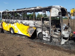 The bus owned by Yellow Bus Lines after it was torched by suspected New People's Army rebels in Tupi town in South Cotabato province in the Philippines. (McLha Dhaldives Joven Tonacao)