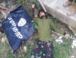 Military photos released to the regional newspaper Mindanao Examiner show one of the four slain BIFF members and weapons seized from an ISIS supporter in Maguindanao province in southern Philippines. (Mindanao Examiner)