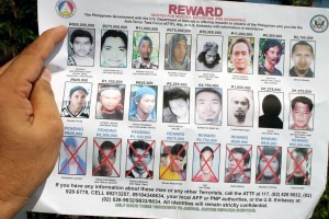 Wanted posters show photographs of Isnilon Hapilon, who is the emir of ISIS in the Philippines. (Mindanao Examiner Photo)